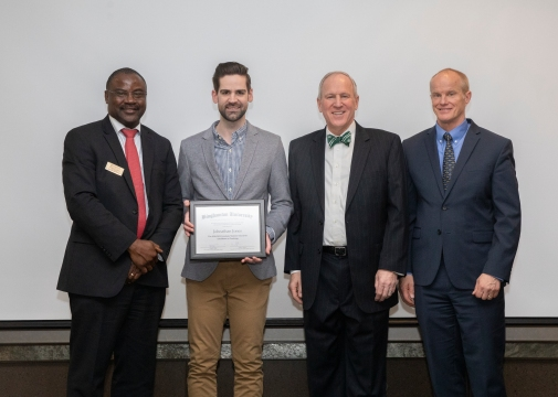 Receiving Binghamton's 2019 Graduate Student Excellence in Teaching award, pictured with university administrators, April 2019